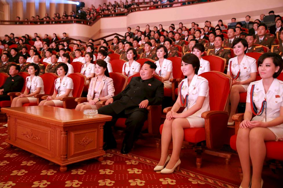 North Korean leader Kim Jong Un and wife Ri Sol Ju enjoy an art performance given by the Chongbong Band to mark the 70th anniversary of the founding of the Workers' Party of Korea (WPK) in this undated KCNA photo