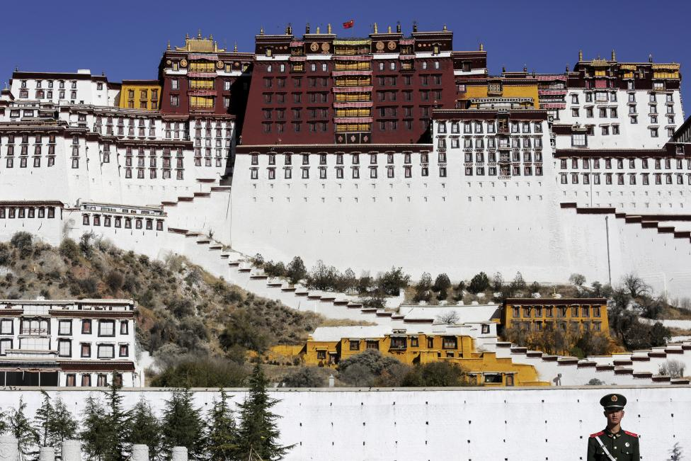 A paramilitary policeman stands guard in front of the Potala Palace in Lhasa, Tibet Autonomous Region